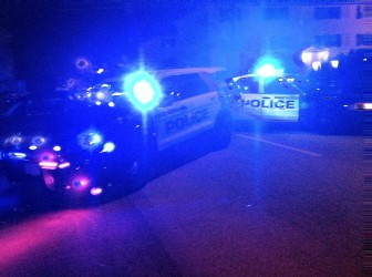 Police cars block Beech Street following a shooting Wednesday night.