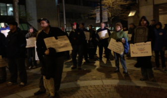 USPS NH American Postal Workers Union vigil at City Hall in Manchester, NH.