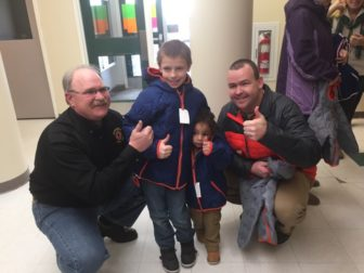 Jeff Duval, left, and Brendan Burns, right, with the Barrette boys, recipients of new winter coats through Operation Warm.