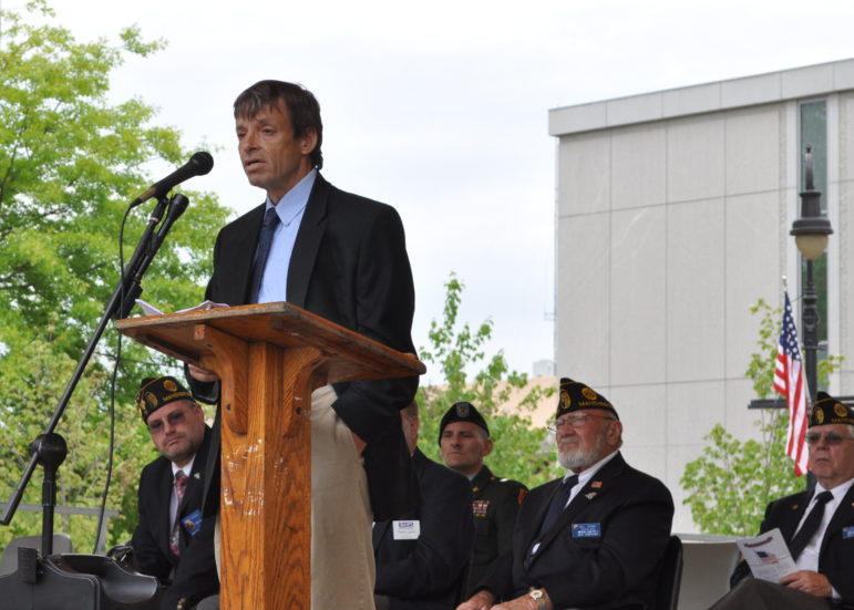 Keith Howard, Executive Director of Liberty House, addresses the post-parade crowd on May 25 at Veterans Park.