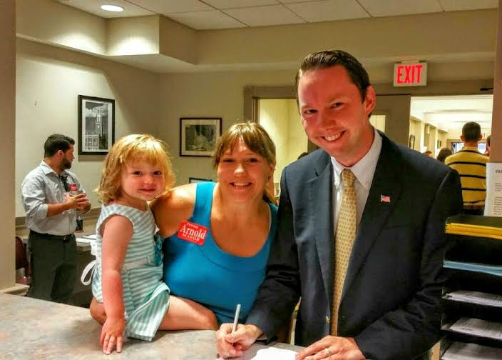 Mayoral candidate Patrick Arnold files his paperwork at City Hall with wife Kathy and daughter, Abigail.