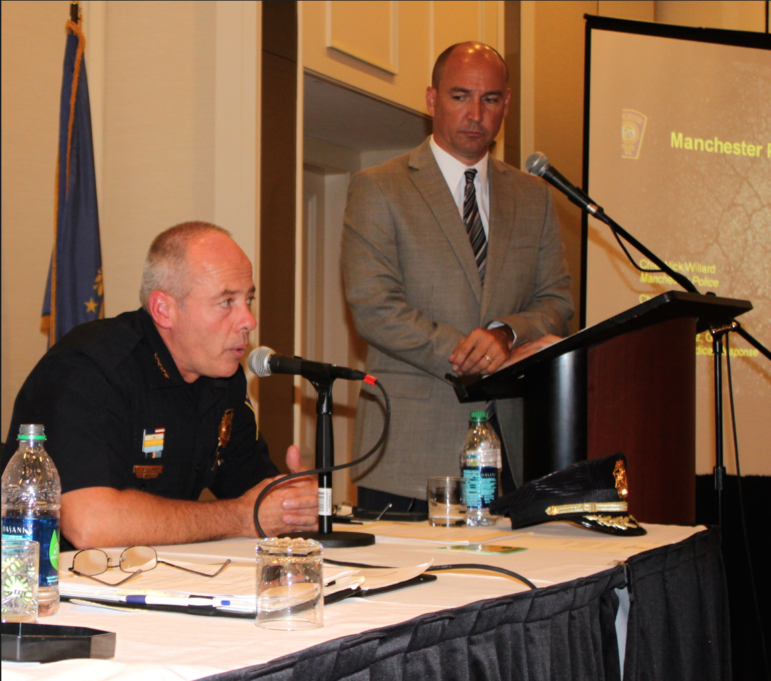 Chief Nick Willard leading a community forum on the heroin crisis at the Radisson.