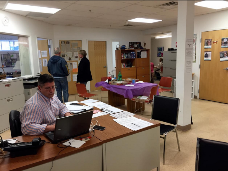 Dana Lemire, left, mans the desk inside Hope for NH Recovery's temporary home at 140 Central St.