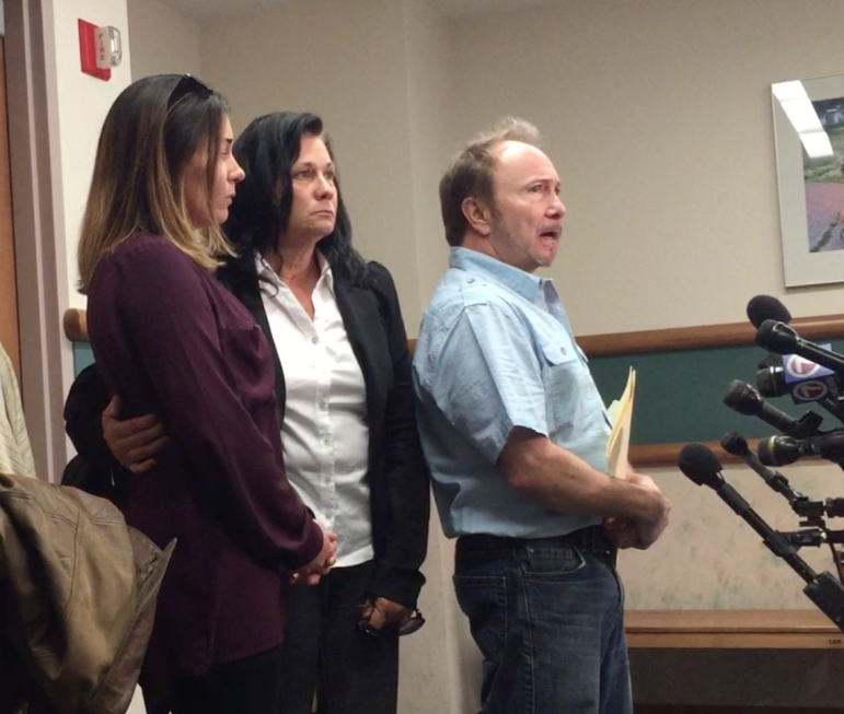 Ian MacPherson's parents and sister stand together outside the courtroom to make a brief statement.