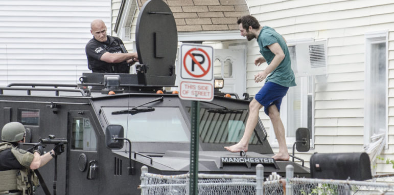 A man who was barricaded inside a residence on Krakow Avenue exited through a window and onto the hood of the SWAT vehicle after tear gas was used.
