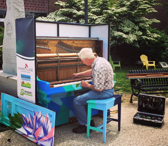"Nashua's ""Lotus"" piano getting a tune up."