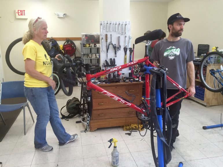 Abby Easterly, left, and shop manager Tyler Glodt, during recent Sunday office hours at QC Bike Collective.