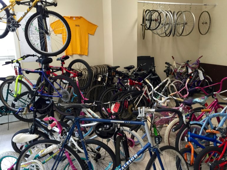 Bikes in various stages of repair, many ready for sale, at QC Bike Collective.