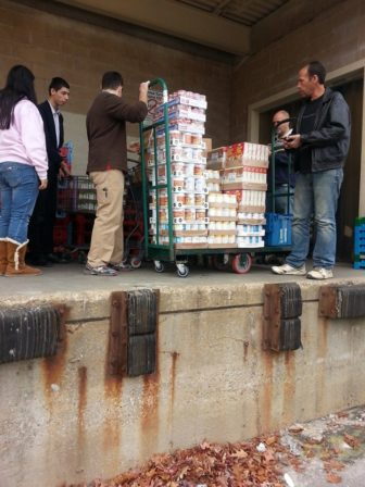 Loading up the canned goods.