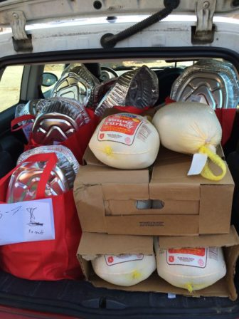 A load of turkeys and dinner bags, packed and ready to deliver.