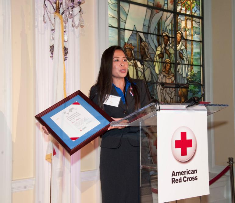 Red Cross Services volunteer Bao Dang accepts the 2013 International Humanitarian Award in Washington, D.C.