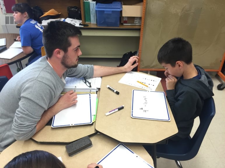 SNHU student Adam Mullen works with a Weston student during a work session.