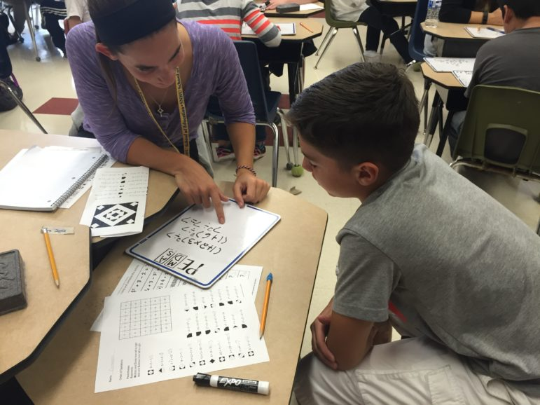 Devan Rabidou, a student-teacher from SNHU, works one-on-one with Giovanni, a Weston Elementary student.