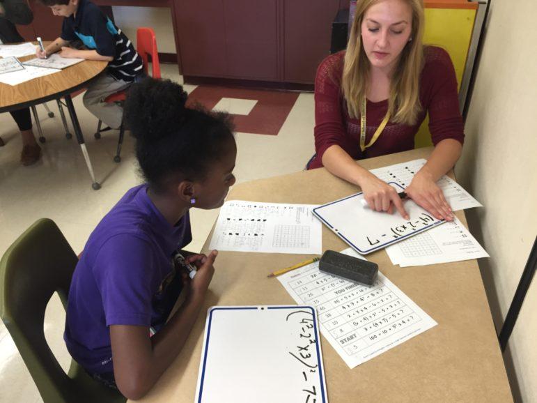 Kristen Wallker puts into practice her student teaching skills with Weston Student Kiyauna.
