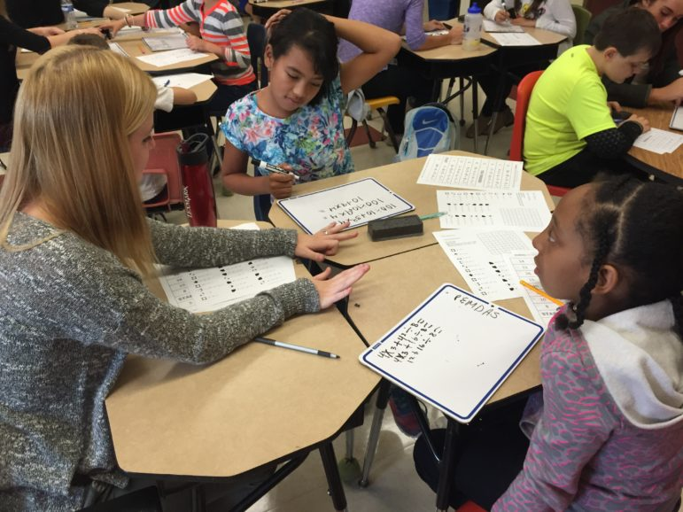 SNHU student Taylor MacDowell, left, working with Weston students.