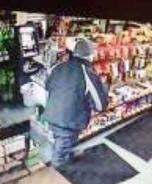 Surveillance photo of robber leaving Budget Gas on Jan. 30.