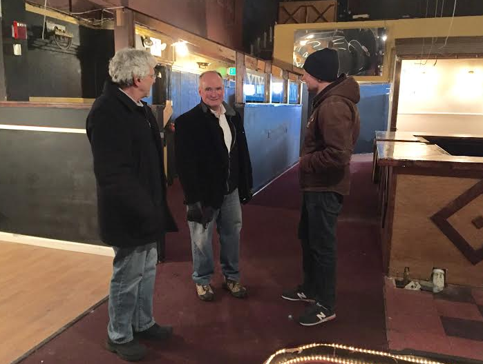 Stu Arnett, center, cats inside 23 Amherst St. with William Kanteres of Kanteres Real Estate, and Matt Wilhelm, right, of Old Sol Music Hall.