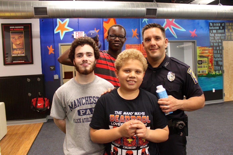 "From left: Michael Correa, Majak Kon, Joskar ""Rainbow"" Bautista and Officer John Lavasseur."