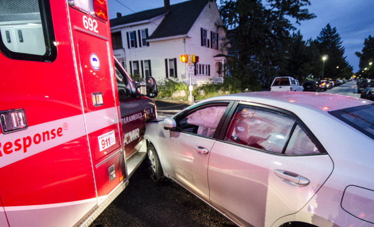 Crash involving AMR ambulance and car.