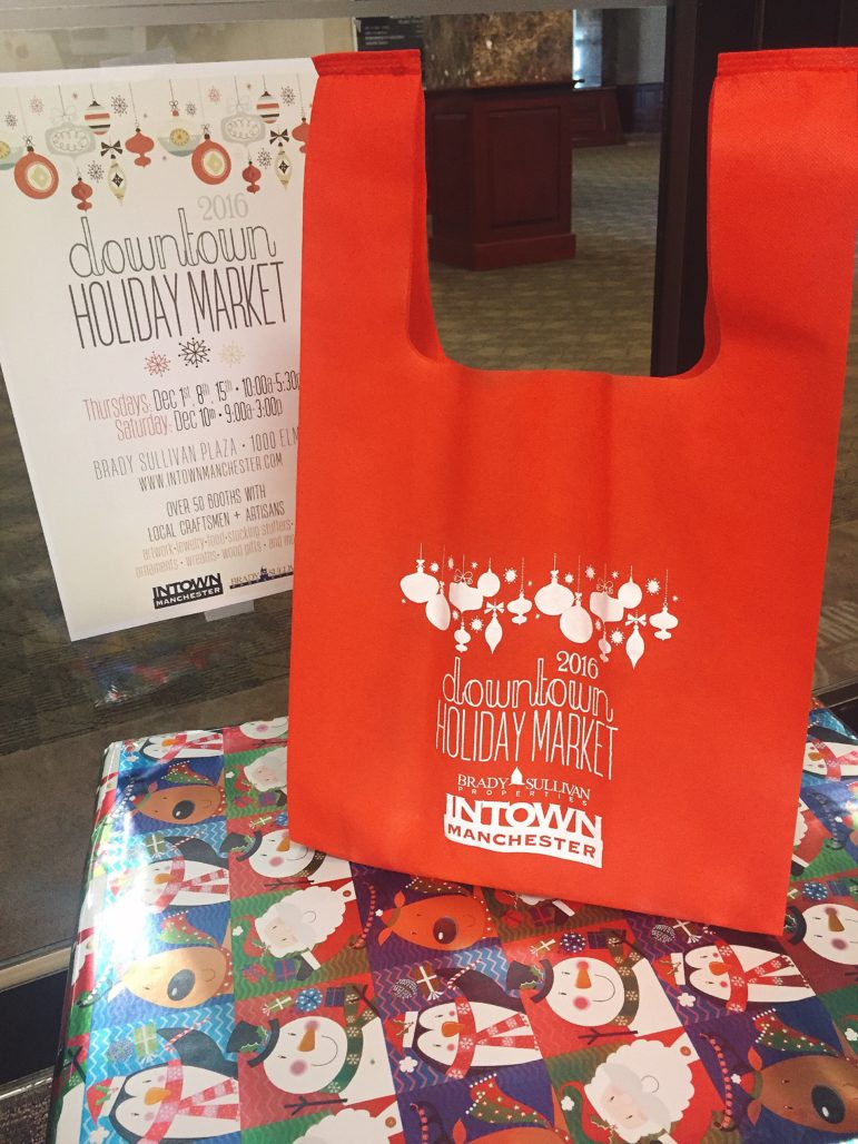 """Get your exclusive """"holiday tote bag"""" so you can fill it with goodies from Intown Manchester's Holiday Market."""