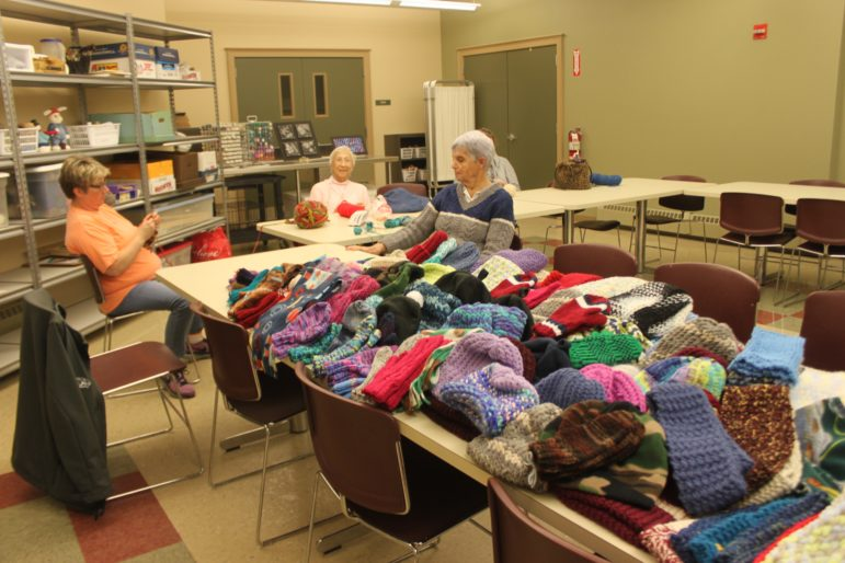 "For months, the ""Hookers"" crochet group at the William B. Cashin Senior Center, have been knitting and crocheting to keep school kids warm."