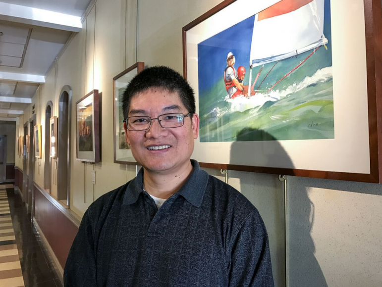 MAC welcomes Yong Chen, pictured here with one of his watercolor pieces on display at City Hall throughout the month of December.