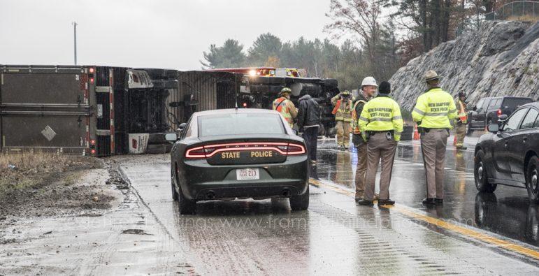 Tractor-trailer slides off I-93, overturns, snarls traffic